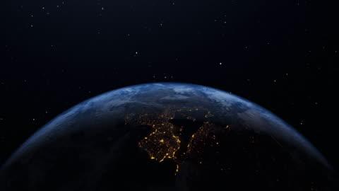 ciclo di rotazione della terra con luci notturne della città - girare video stock e b–roll