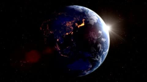 ciclo di rotazione della terra di notte con luci laterali - girare video stock e b–roll