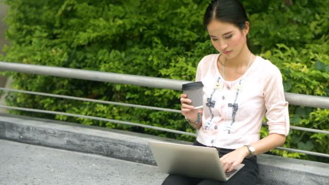 East Asian Culture : Asian woman using digital tablet in garden video