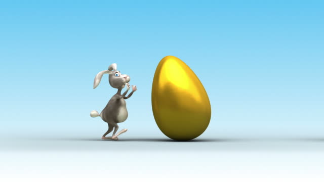 Easter Bunny drag a golden egg. video