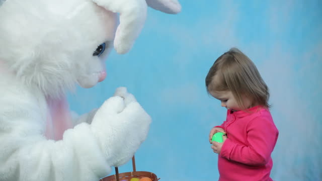 Easter bunny gives eggs to child video