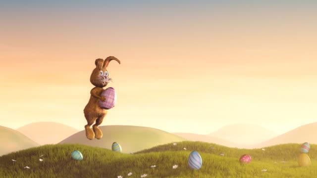 easter bunny jumping mit dekorierten ei - osterhase stock-videos und b-roll-filmmaterial