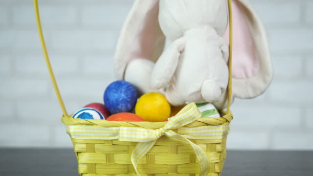 Easter bunny with a basket of eggs.