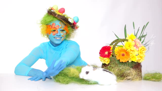 Easter bunny with painted eggs and Blue Girl video
