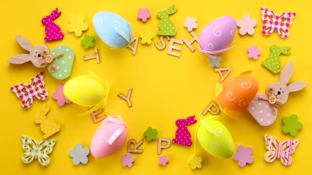 easter decoration on yellow background with happy easter text - pasqua video stock e b–roll