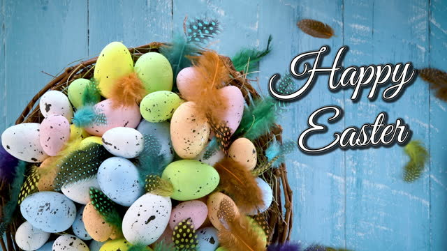Easter eggs in a nest on blue background