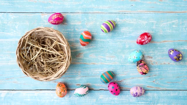Easter eggs in basket, color plate and flower stop motion animation.