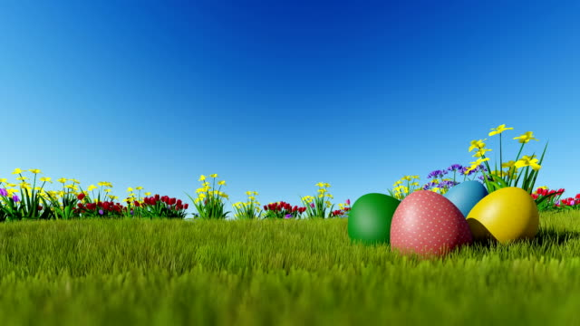 Easter eggs on green meadow over blue sky, Luma Matte attached video