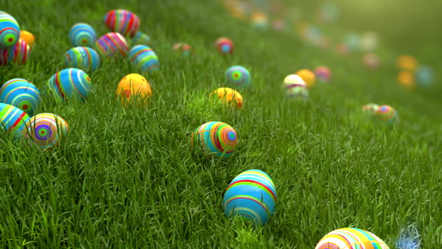 easter eggs on the grass. easter eggs slide down the slope covered with green cereal. sunny positive climate. - pasqua video stock e b–roll