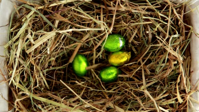 Easter eggs packed falling in the straw video