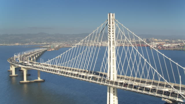 Eastern Bay Bridge Traffic - Drone Shot Aerial shot of the eastern section of the Bay Bridge, that spas San Francisco bay between Yerba Buena Island and Oakland. The Port of Oakland is visible in the distance. oakland stock videos & royalty-free footage