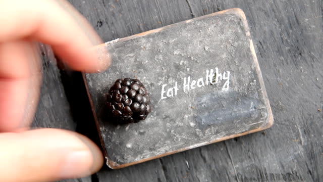 Eat heathy text. Fruit diet, dieting, nutrition, vegetarian concept. Food for beautiful skin, strong immune system, diet fitness meal. Heathy snack. video