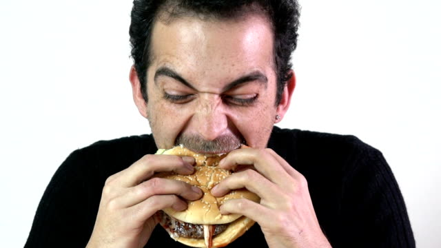 eating a burger slow motion - burgers stock videos and b-roll footage