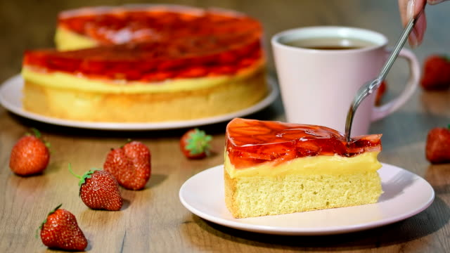 eating a piece strawberry cake with jelly. - sostanza gelatinosa video stock e b–roll