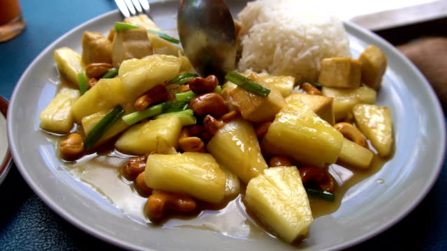 Eating Asian Pineapple and Cashew Nut Dish with Rice video