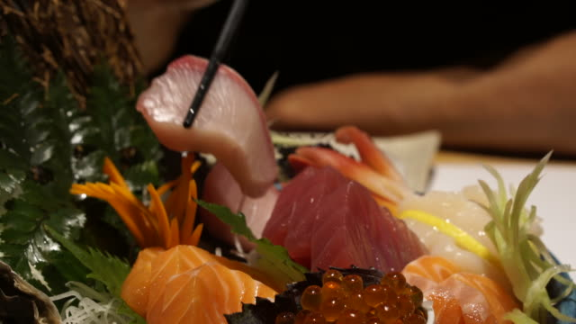 Eating Assorted Salmon Sashimi beautiful Japanese cuisine Eating Assorted Salmon Sashimi beautiful Japanese cuisine sashimi stock videos & royalty-free footage