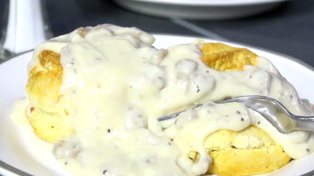 Eating biscuits with country gravy