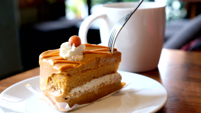 eating cake in coffee shop - desserts stock videos and b-roll footage