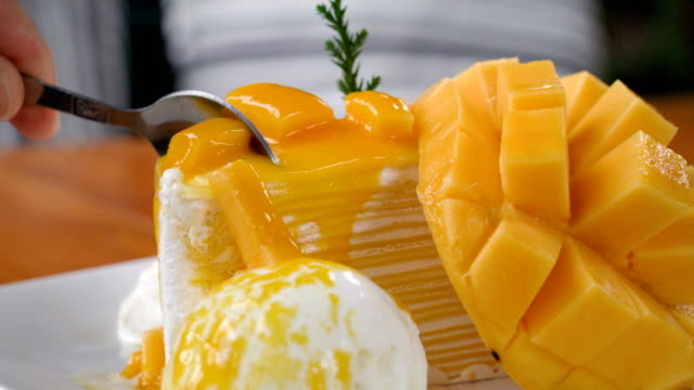 Eating Crepe cake with Mango. video