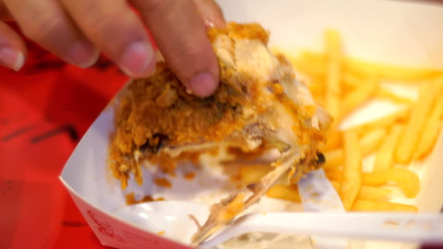 cu:eating fried chicken strip on the dish - junk food stock videos and b-roll footage