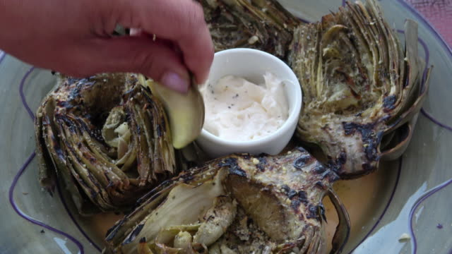 Eating Grilled Artichoke with Aioli video