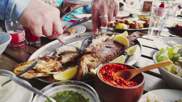 Eating Grilled Fish in Restaurant video