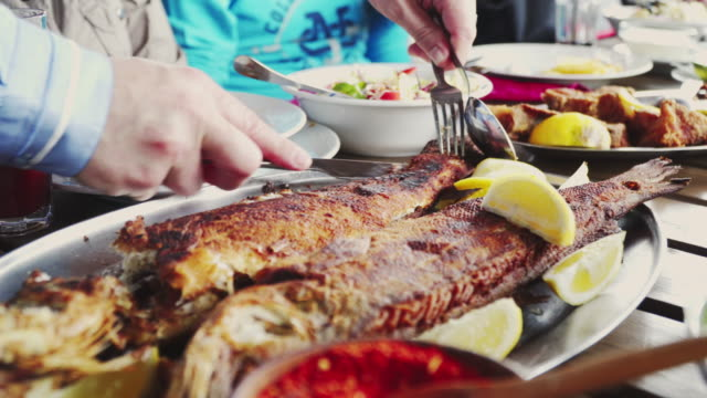 eating grilled fish in restaurant - seafood stock videos and b-roll footage
