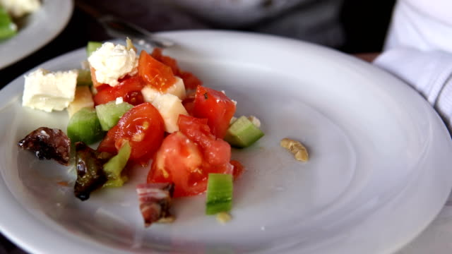 eating healthy fresh vegetable salad with tomato, pepper, onion. closeup with cinematic dof - aglio cipolla isolated video stock e b–roll