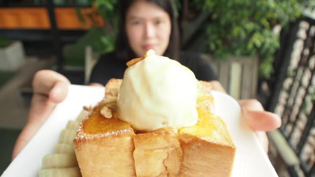 Eating Honey toast ice cream. Slow motion