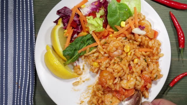 Eating Italian Style King Prawn Risotto With Salad video