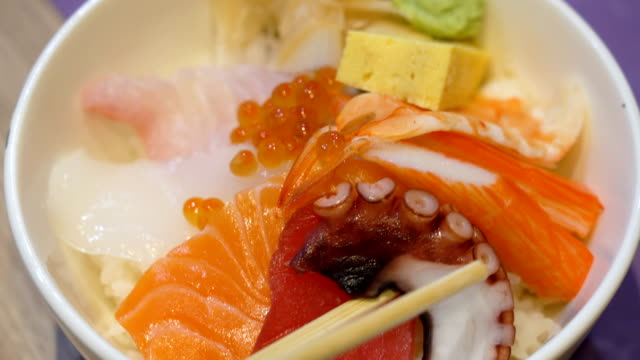 Eating Japanese food. 4K CS 2 shot Eating Japanese food. shrimp seafood stock videos & royalty-free footage