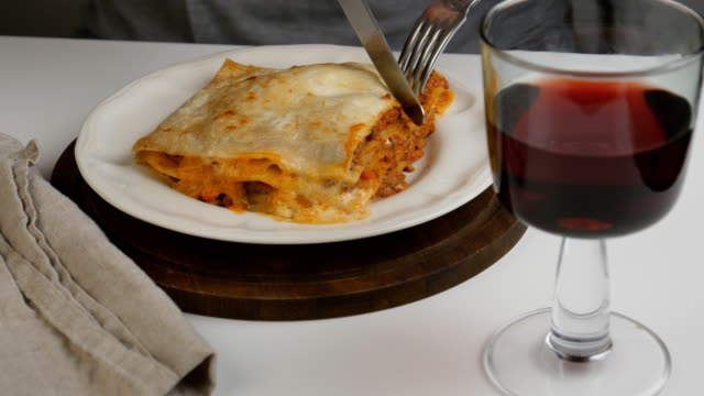 eating lasagna bolognese - italian food stock videos & royalty-free footage