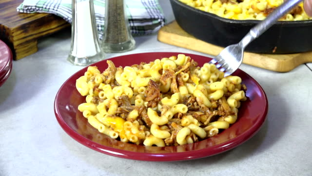 Eating macaroni and cheese with beef Taking a forkful of macaroni and cheese with beef macaroni stock videos & royalty-free footage