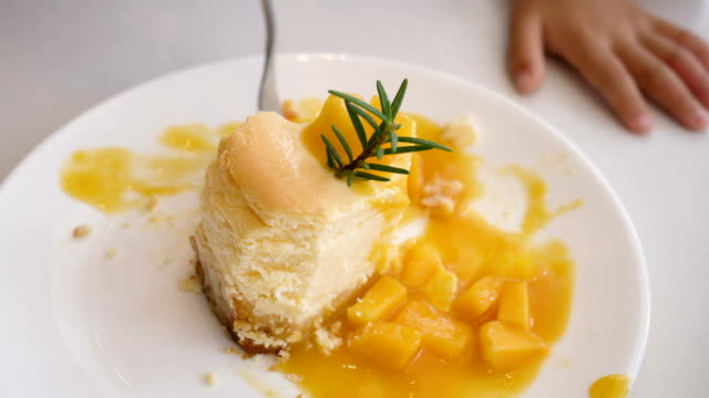 Eating Mango cheese cake. video