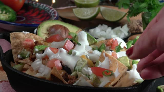 Eating Nachos Closeup Woman Eating Nachos Baked in a Cast Iron Skillet dipping sauce stock videos & royalty-free footage