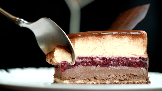 slo mo - eating opera cake with spoon - desserts stock videos and b-roll footage