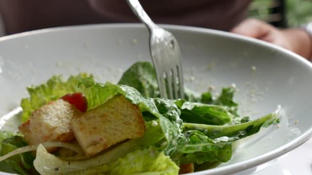 Eating Salad Eating Salad tomato salad stock videos & royalty-free footage