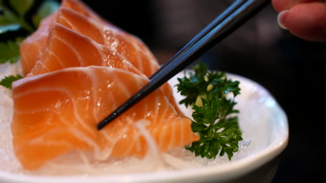 Eating salmon sashimi, 4K(UHD) video