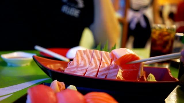 Eating salmon sashimi. video