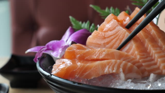 Eating salmon sashimi Eating salmon sashimi sashimi stock videos & royalty-free footage