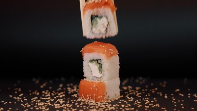 Eating salmon sushi, macro video video
