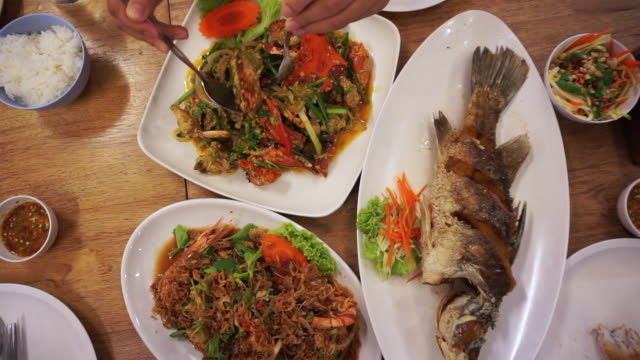 Eating scene top view Thai seafood fish crabs and prawns