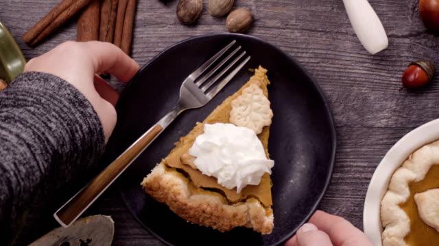 eating slice of freshly baked  pumpkin pie. - sweet pie stock videos & royalty-free footage