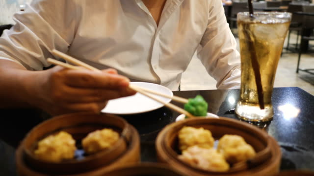 eating steamed dim sum - thai food stock videos and b-roll footage