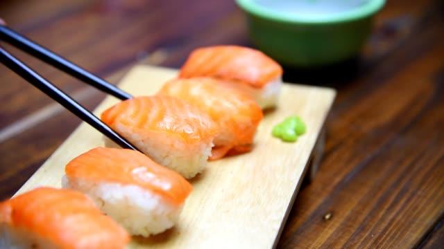 Eating sushi  using chopsticks Eating sushi  using chopsticks ginger spice stock videos & royalty-free footage