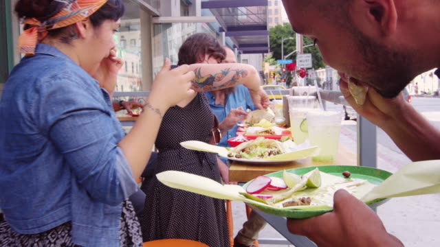 Eating Tacos Outside Downtown Taqueria