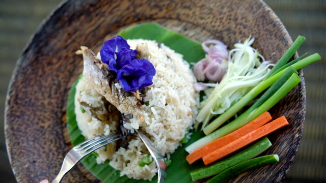 Eating Thai food - fried rice with mackerel (Pla too). video