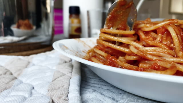 eating tomato spaghetti with a fork. italian cuisine. - cucina mediterranea video stock e b–roll