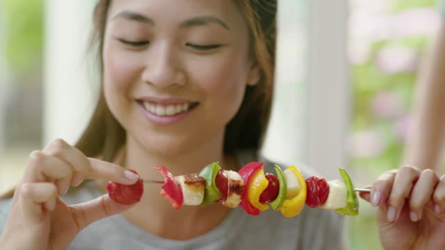eating vegetable kebab. - spiedino video stock e b–roll
