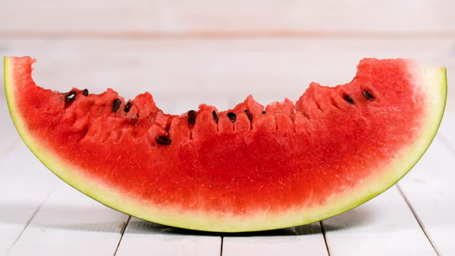Eating watermelon slice Eating watermelon slice, stop motion animation watermelon stock videos & royalty-free footage